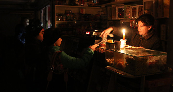 Shoppers pay for their purchases in a store during a power outage. File photo