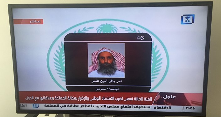 Saudi Arabia's state television channel displays an image of Sheikh Nimr al-Nimr, Saturday, Jan. 2, 2016, Dubai