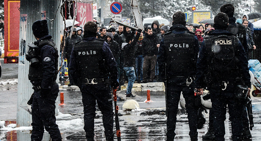 Turkish riot police officers block the crowd as they shout slogans on December 31, 2015 in Diyarbakir, during a demonstration after a curfew was lifted from the city