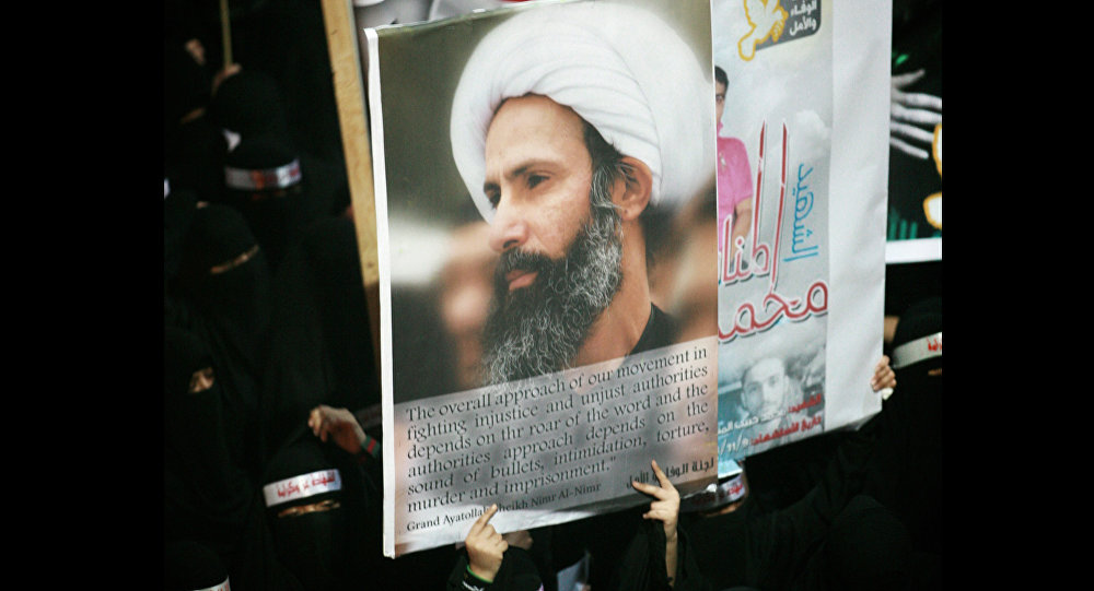 FILE - In this Sunday, Sept. 30, 2012 file photo, a Saudi anti-government protester carries a poster with the image of jailed Shiite cleric Sheik Nimr al-Nimr during the funeral of three Shiite Muslims allegedly killed by Saudi security forces in the eastern town of al-Awamiya, Saudi Arabia