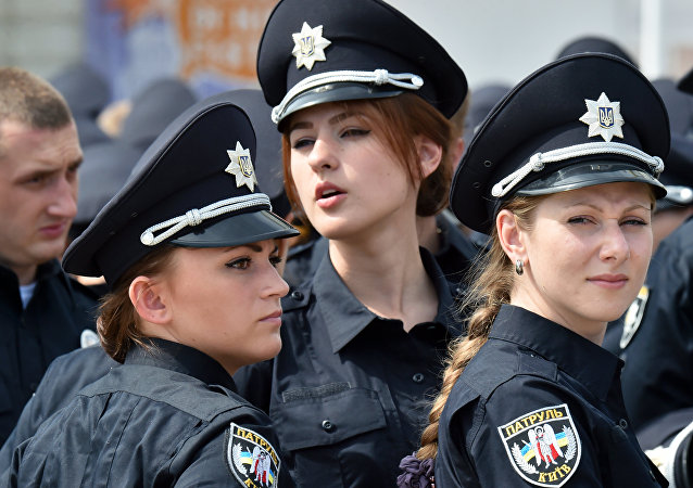 Police officers look on prior to an official ceremony in Kiev, on July 4, 2015