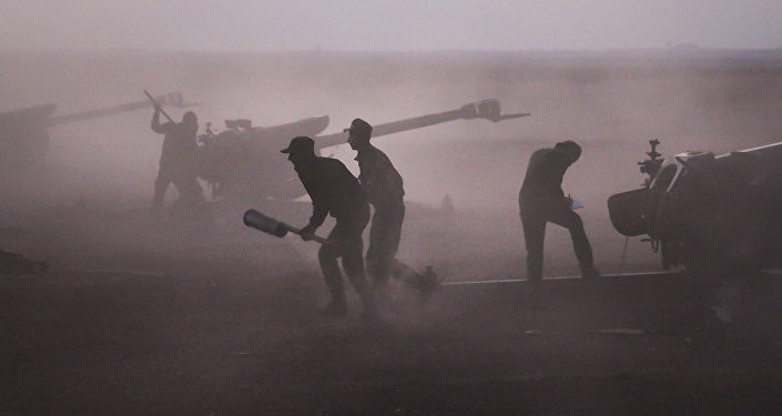 Syrian army personnel load howitzers near the village of Morek, Syria on Wednesday, Oct. 7, 2015