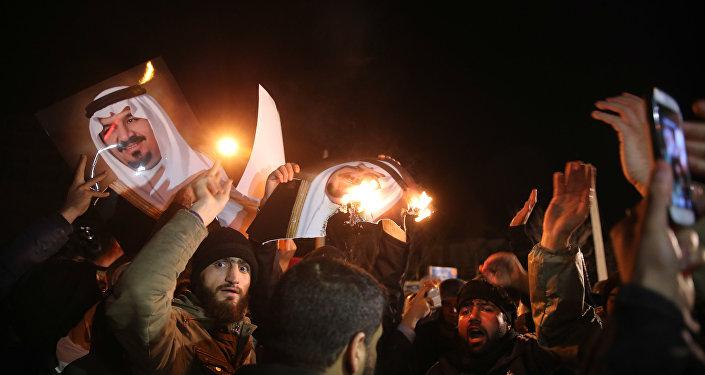Iranian protesters gather outside the Saudi Embassy in Tehran during a demonstration against the execution of prominent Shiite Muslim cleric Nimr al-Nimr by Saudi authorities, on January 2, 2016
