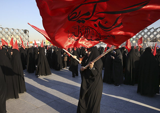 Iranian women wave flags that read, Death to America and we shall never accept humiliation, during a rally to protest the execution by Saudi Arabia last week of Sheikh Nimr al-Nimr, a prominent opposition Saudi Shiite cleric, in Tehran, Iran, Monday, Jan. 4, 2016