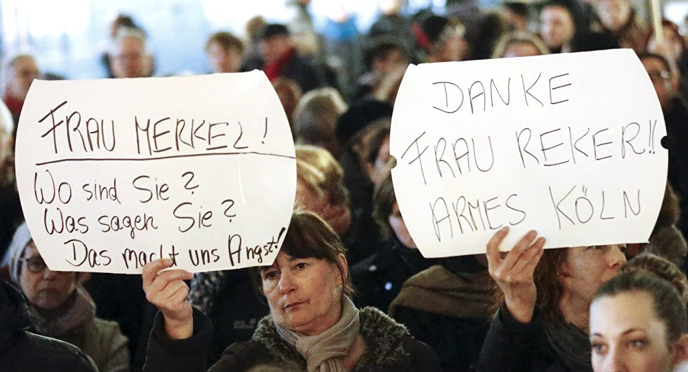 Women hold up placards that read Mrs. Merkel: Where are you? What are you saying? This worries us! and Thanks (Cologne mayor Henriette) Reker!! Poor Cologne (R) during a protest in front of the Cologne Cathedral, Germany, January 5, 2016