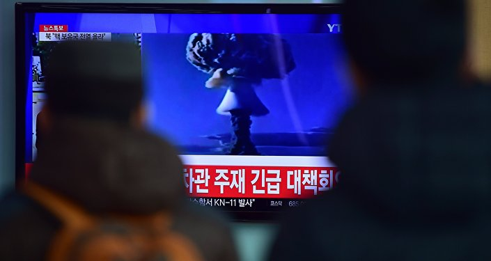 People watch a news report on North Korea's first hydrogen bomb test at a railroad station in Seoul on January 6, 2016.
