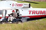 Donald Trump pilots some Trump vehicles around Trump Turnberry.