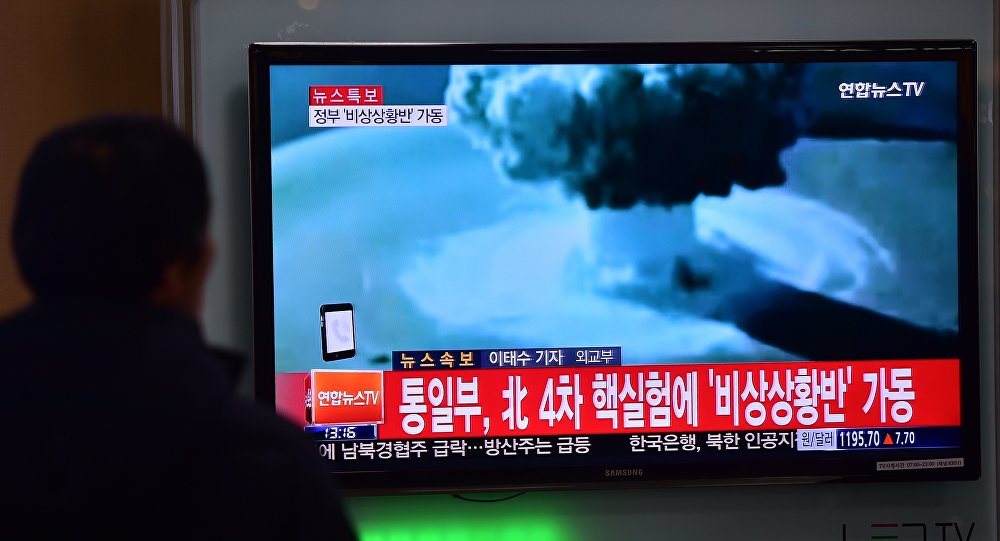 People watch a news report on North Korea's first hydrogen bomb test at a railroad station in Seoul
