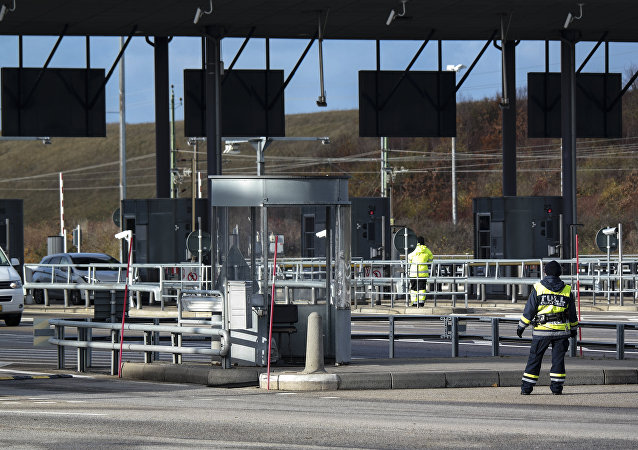 Cars arrive from Denmark to the toll and customs station at Lernacken on the Swedish side of the Oresund strait