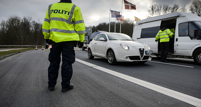 Danish Police officers check vehicles