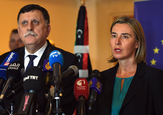 Libyan Prime Minister Fayez al-Sarraj (L) and EU foreign policy chief Federica Mogherini (R) attend a joint press conference in Tunis on January 8, 2016.