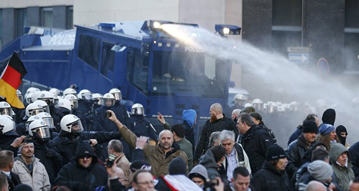 Police use a water cannon during a protest march by supporters of anti-immigration right-wing movement PEGIDA (Patriotic Europeans Against the Islamisation of the West) in Cologne, Germany, January 9, 2016