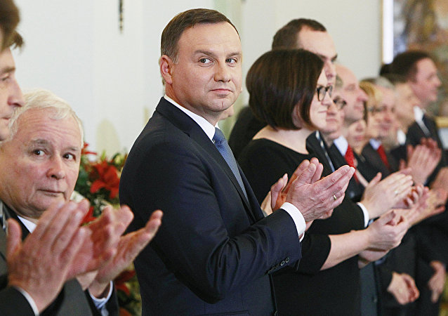 Polish President Andrzej Duda,center, and the leader of Law and Justice party Jaroslaw Kaczynski, second left, attend the Prime Minister nomination ceremony for Beata Szydlo in the Presidential Palace in Warsaw, Poland, Friday, Nov. 13, 2015