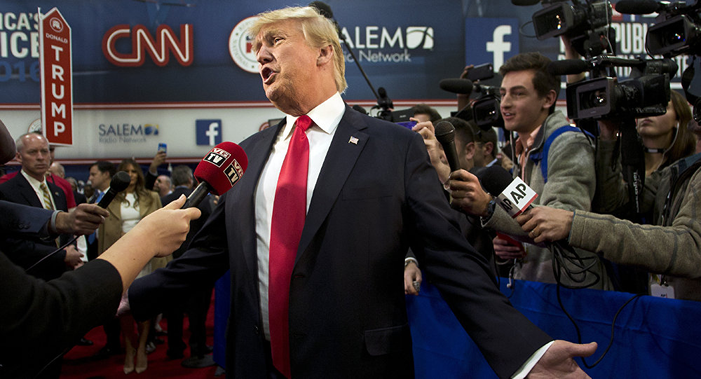 Republican presidential candidate businessman Donald Trump speaks with the media in the Spin Room following the Republican Presidential Debate, hosted by CNN, at The Venetian Las Vegas on December 15, 2015 in Las Vegas, Nevada