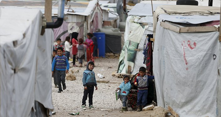 Syrian children are seen inside an informal settlement for Syrian refugees in Bar Elias, Bekaa valley, Lebanon, January 6, 2016