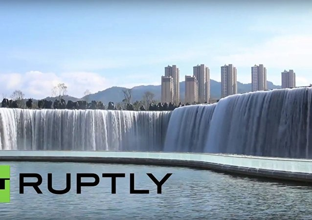 Visitors flock to see Asia's largest manmade waterfall