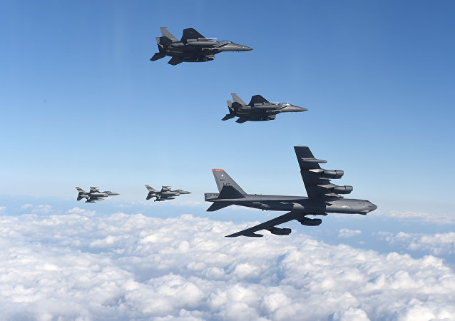 This picture taken by the Republic of Korea Air Force on January 10, 2016 and released via Yonhap news agency shows a US B-52 Stratofortress (bottom R) flying with South Korean F-15K fighter jets (top) and US F-16 fighter jets (bottom L) over South Korea