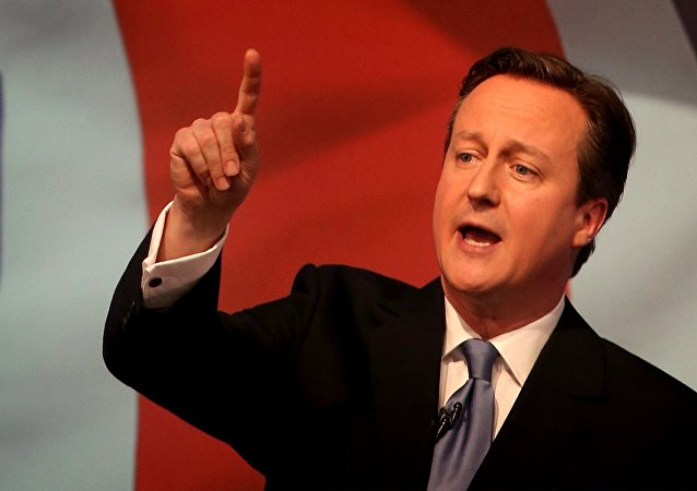 Britain's Prime Minister David Cameron gestures as he unveils the Conservative party manifesto, in Swindon, England, Tuesday April 14, 2015.