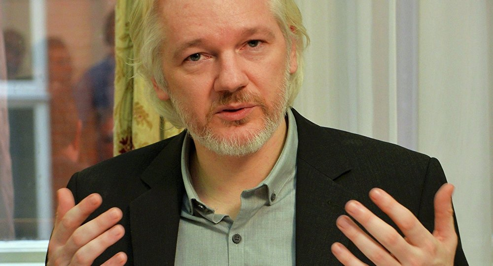WikiLeaks founder Julian Assange gestures during a news conference at the Ecuadorian embassy in central London, Britain, in this August 18, 2014 file photo