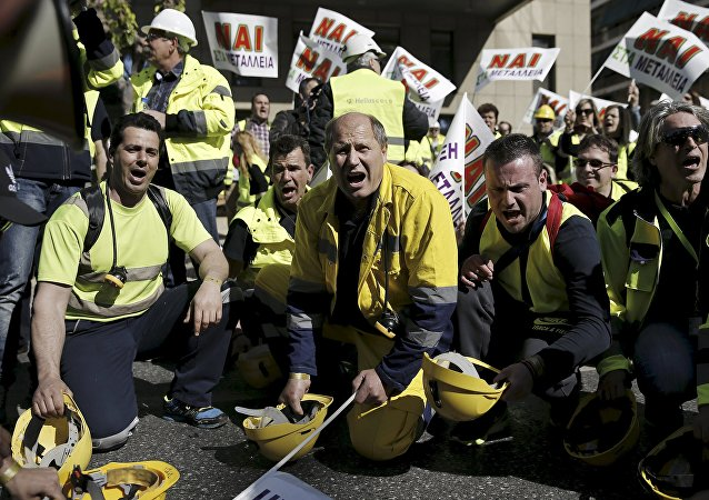 Miners of a gold mine in northern Greece hit their helmets on the ground during a protest outside the Ministry of Development in favour of an investment of Canadian Eldorado Gold corporation in Athens, Greece in this April 16, 2015 file photo