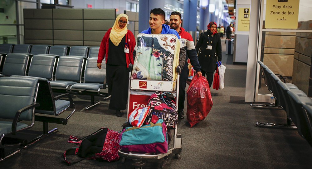 Syrian refugees arrive at the Pearson Toronto International Airport in Mississauga, Ontario