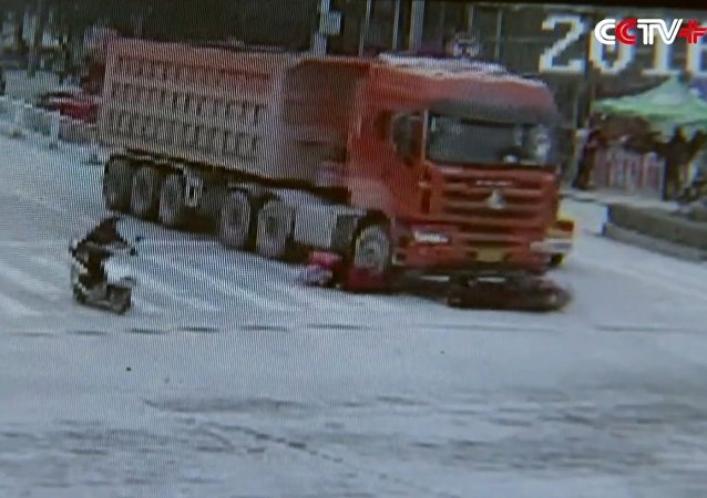 Three women barely avoid being squashed by truck
