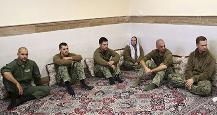 This picture released by the Iranian Revolutionary Guards on Wednesday, Jan. 13, 2016, shows detained American Navy sailors in an undisclosed location in Iran. Less than a day after 10 U.S. Navy sailors were detained in Iran when their boats drifted into Iranian waters, they and their vessels were back safely Wednesday with the American fleet