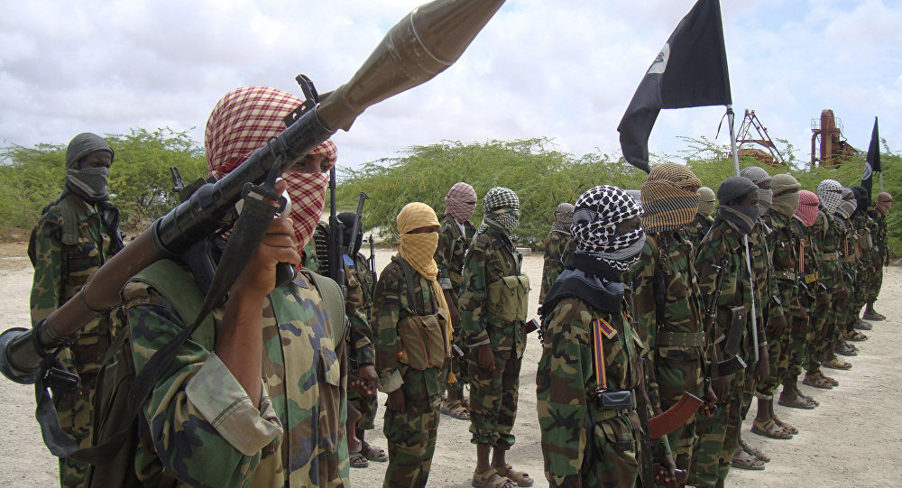 Al-Shabaab fighters display weapons as they conduct military exercises in northern Mogadishu, Somalia