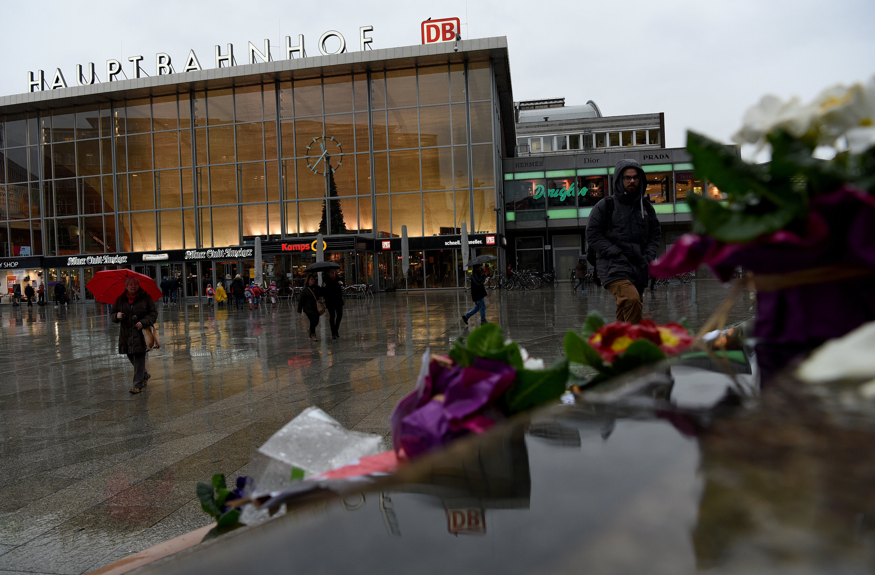 Flowers and letters of protest are laid down on the steps in front of the Cologne main train station in Cologne, western Germany on January 11, 2016
