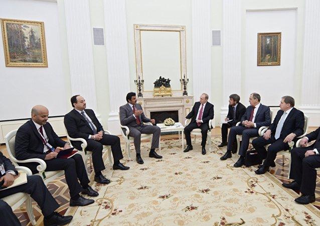 President Vladimir Putin meets with Qatar Emir Tamim bin Hamad Al-Thani