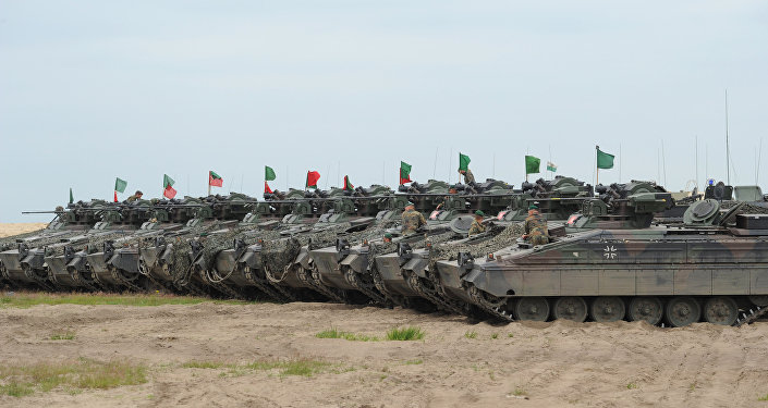 German army tanks are lined up after the NATO Noble Jump exercise on a training range near Swietoszow Zagan, Poland, Thursday, June 18, 2015