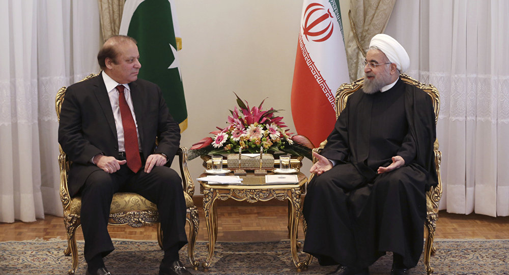 Iranian President Hassan Rouhani, right, and Pakistani Prime Minister Nawaz Sharif make their way to a meeting in Tehran, Iran, Tuesday, Jan. 19, 2016