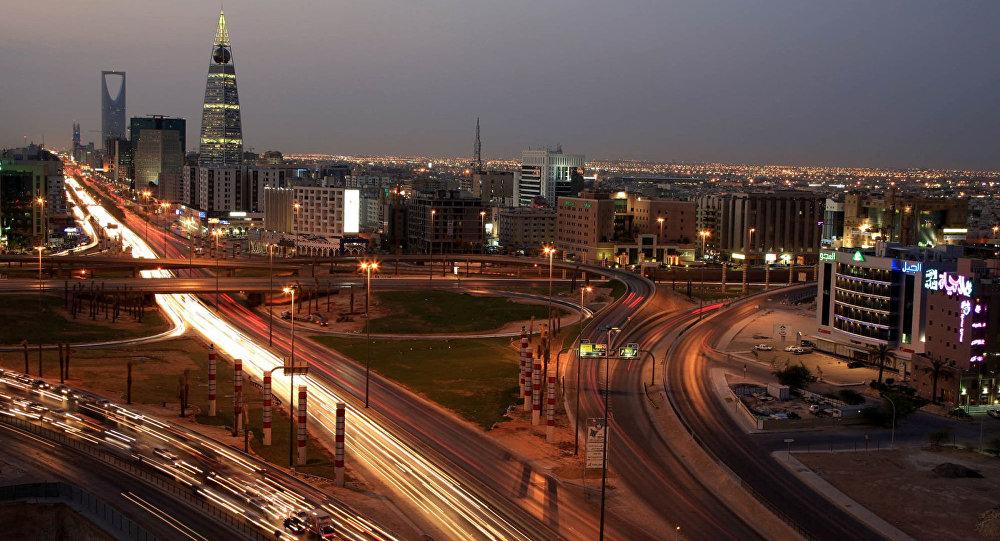 Saudi Arabian city view with the 'Kingdom Tower', background, and 'Al-Faislia Tower' in Riyadh, Saudi Arabia