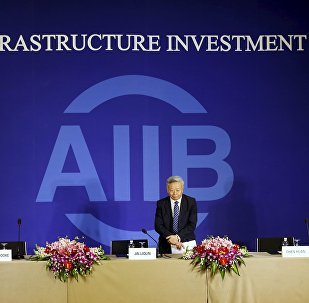 President of Asian Infrastructure Investment Bank (AIIB) Jin Liqun greets to journalists as he arrives at a news conference in Beijing January 17, 2016