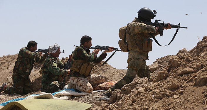 Iraqi soldiers and Shiite fighters from the popular committees hold a post as they fire towards Islamic State (IS) group positions in the Garma district of Anbar province west of the Iraqi capital Baghdad. (File)