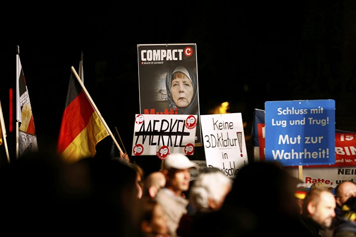 Supporters of the right-wing Alternative for Germany (AfD) demonstrate against the German government's new policy for migrants, in Erfurt, Germany October 21, 2015.