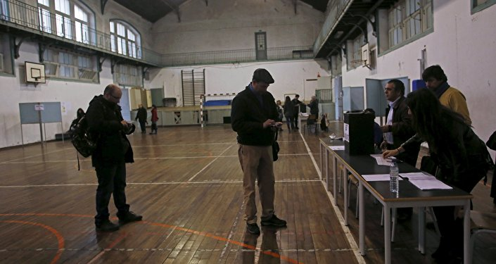 People wait to vote at a polling station during Portugal's presidential elections in Lisbon, Portugal