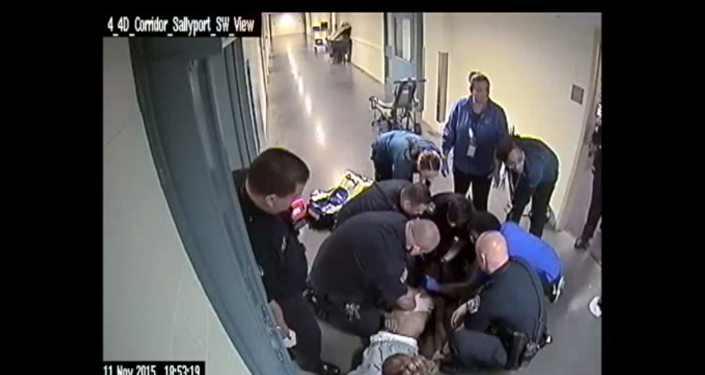 Screenshot of a video from a jail in Denver showing a police response to an inmate choking to death