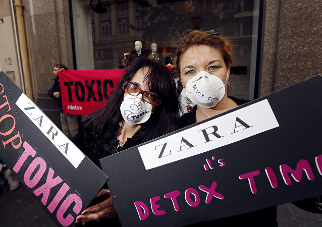 French activists of Greenpeace International NGO wear masks reading Toxic and Detox Time during a demonstration in front of a fashion store Zara, on November 24, 2012 in Nice, southeastern France, to protest against hazardous chemicals in clothing