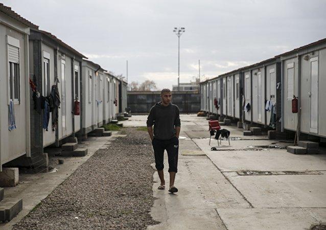 A refugee walks inside the Eleonas refugee camp in Athens, Greece, January 5, 2016
