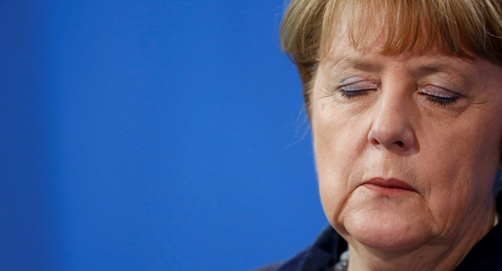 German Chancellor Angela Merkel listens during a joint news conference with Romania's Prime Minister Dacian Ciolos (not pictured) at the Chancellery in Berlin, Germany, January 7, 2016.