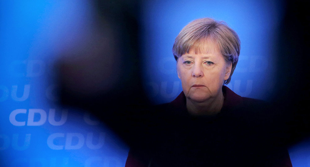 German chancellor Angela Merkel speaks during a press conference after a meeting with leading politicians at her CDU party in Mayence, central Germany, on January 9, 2016
