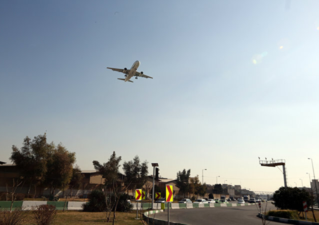 A passenger plane prepares to land at Mehrabad airport in the Iranian capital Tehran on January 18, 2016