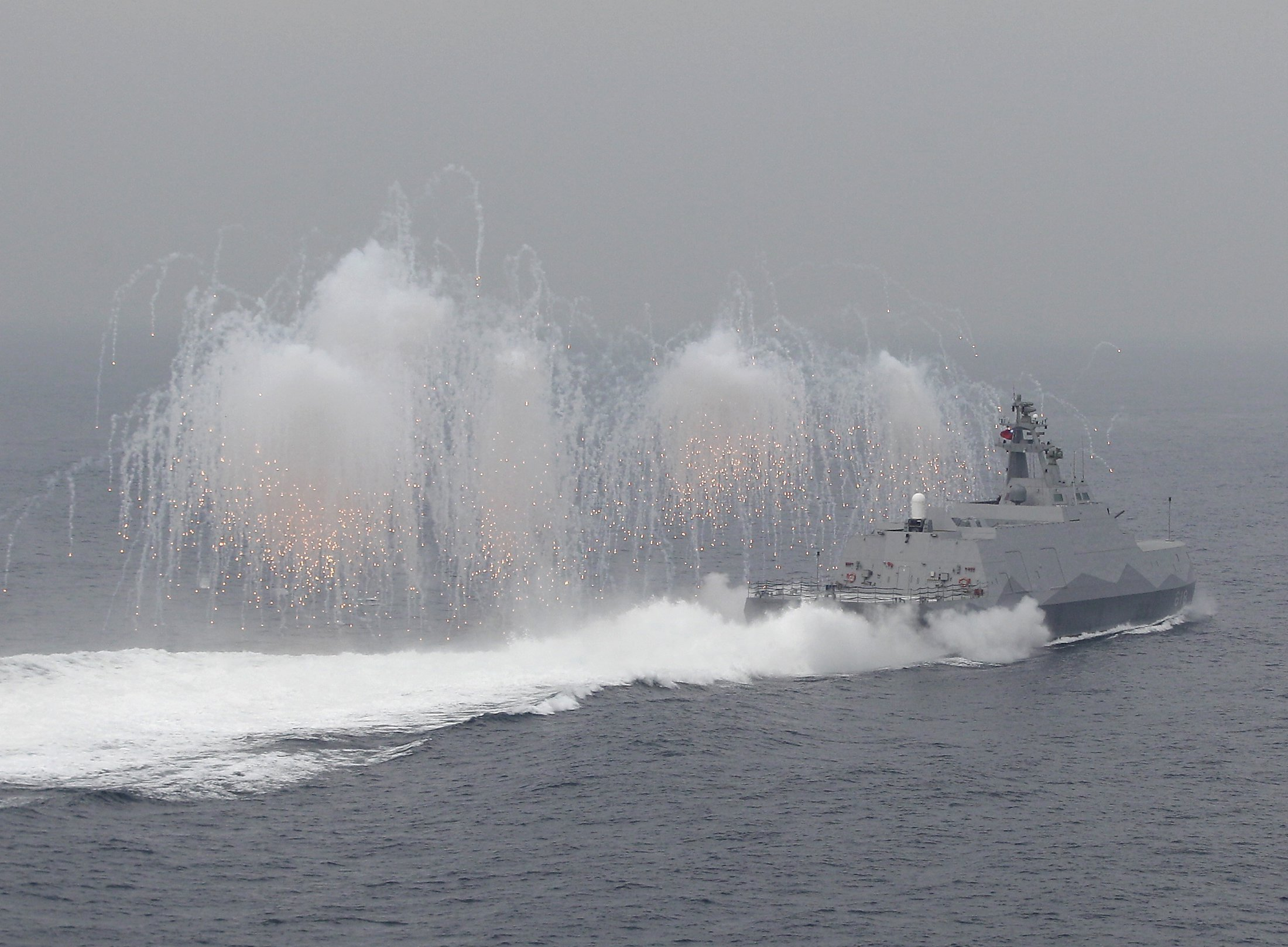 Flares are set off from a Taiwan navy missile ship.