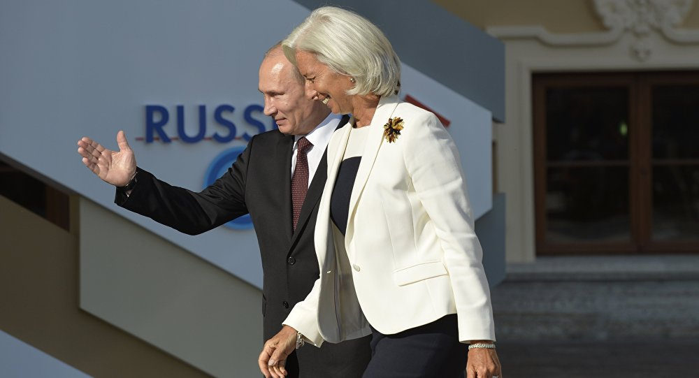 Russia's President Vladimir Putin (L) welcomes International Monetary Fund (IMF) Managing Director Christine Lagarde at the start of the G20 summit on September 5, 2013 in Saint Petersburg