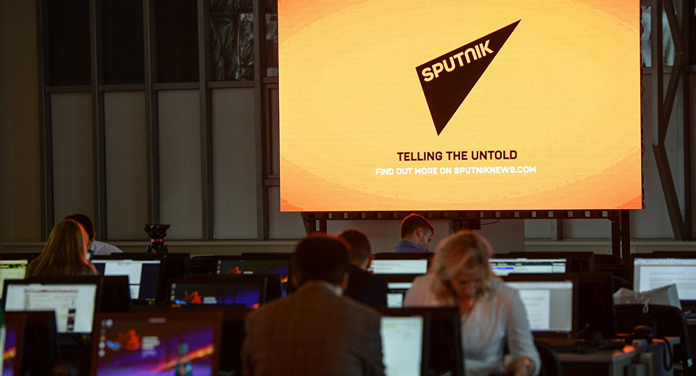 A screen featuring the logo of the Sputnik International News Agency and Radio seen at the media center of the Eastern Economic Forum, Vladivostok