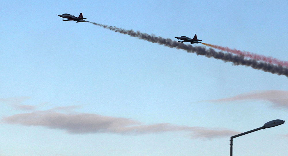 The Turkish Air Force, Turkish Stars aerobatic demonstration team, perform during celebrations of the 31st anniversary of proclamation of the Turkish Republic of Northern Cyprus (TRNC) on November 16,2014, in the Turkish occupied north of the Eastern Mediterranean Island in Kyrenia