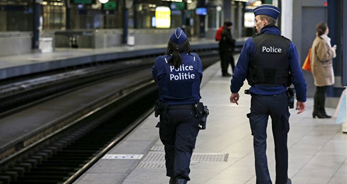 Belgian police officers patrol on a platform at the Thalys high-speed train terminal at Midi/Zuid railway station in Brussels, Belgium, January 7, 2016