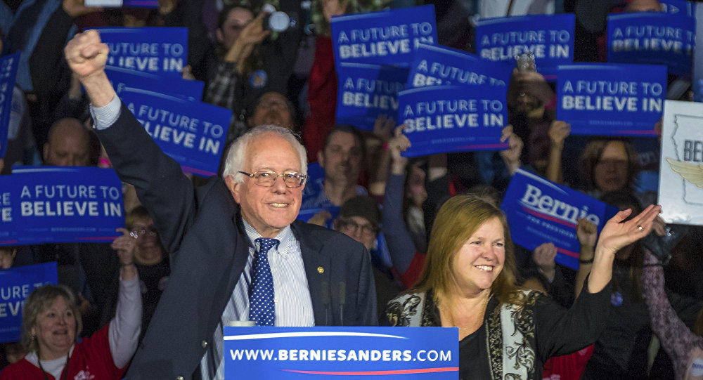 Democratic presidential candidate Bernie Sanders arrives for his caucus night rally in Des Moines, Iowa, on February 2, 2016.