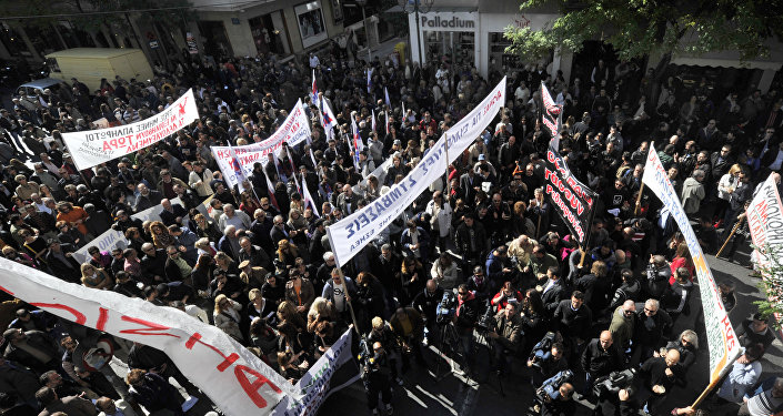 Greek journalists gather outside their union building in Athens during their 24-hour strike on October 18, 2011 (File)